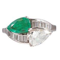 1950s 1.08 Carat Emerald 0.83 Carat Diamond Platinum Bypass Ring 1