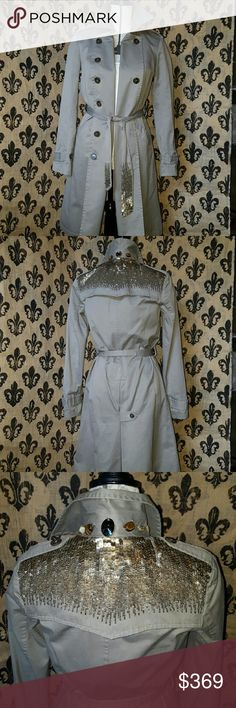 🍒GRYPHON sexy Trench coat No sign of wear!  Incredibly detailed Gryphon of New York tan colored trench coat, the top of the shoulders across the back is a heavy metal sequin as well as a long the bottom of the belt, the back of the neck is jeweled with stunning collectible rocks and Jewels, the front can be worn several ways how I pictured it was my favorite. It is definitely a must own🍒🍒🍒🍒retails for $889.00. Some sequin is missing. See pic.  Please ask any and all questions before…