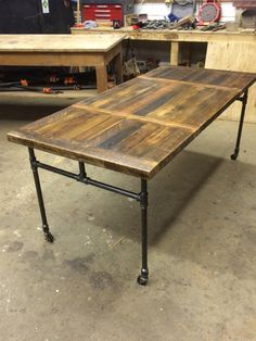 Reclaimed Fir Dining Table with Leaf System & Cast Iron Pipe Legs