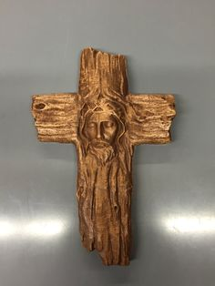 Carved cross with Christ wearing a crown of thorns. by TheLoftyOak