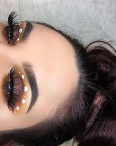WEBSTA @ melisssaspiteri - Had so much fun with this look! The little flowers were more challenging than I anticipated but I'm happy with the outcome. Recreation of one of @giuliannaa's recent looks with my own lil twist Eyeshadow: @anastasiabeverlyhills modern renaissance palette using the shades golden ochre, cyprus umber, raw sienna, burnt orange, and warm taupe.Eye Brushes: @sigmabeauty brushes. Liner: @nyxcosmetics white liquid liner and vivid liner in halo.Lashes: @deviluxurylash in…