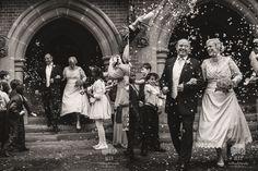 Willian and Judith wedding confetti near the entrance of Grims Dyke Hotel in Watford