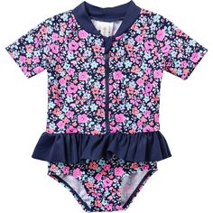 Bring pretty and playful style to her wardrobe with the Girls Zip Swim Costume from Dymples. Offering UPF50+ protection for maximum safety in the sun, this adorable suit features a zip through front with protective zip cover, elasticised leg openings and a short collar. The ruffle trim to waistline and all over floral print complete this navy blue piece.