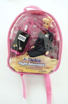 This Delta Airlines flight attendant doll was produced by Daron Worldwide Trading. The 11½ inch doll comes with functioning luggage, removable shoes and is packaged in a small, child size backpack. $16.99 on GoAntiques    #vintage #toys #collectible