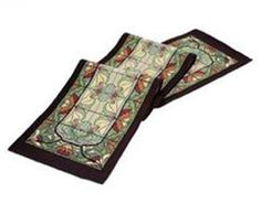 Rennie & Rose Collection 76-Inch Table Runner, Thistle and Rose Bud by Rennie & Rose Collection. $53.95. Poly/Cotton/Acrylic. Machine wash cold, lay flat to dry. dry clean for best results.. One sided design. Rennie and rose thistle and rose bud, table runner 76-inch. The Rennie and Rose Arts and Crafts Collection brings the detail and artistry of a much beloved and timeless era to any home décor. Patterns inspired by flora and fauna, tiles, and stained glass use both bold a...