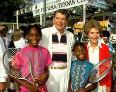 Serena And Venus Williams posing for a picture with former president Ronald Reagan and his wife Nancy in 1990.