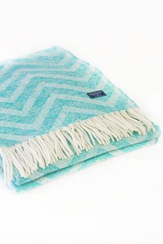 The first day of spring is less than a month away, but that seems like forever when the weather hasn't budged above freezing for a week and you can't remember the last time you saw blue skies. To help make the final days of winter more bearable, we've gathered 15 cozy throw blankets from ultra-luxe knits to brightly colored woolen varieties to cheer you up and keep you warm.