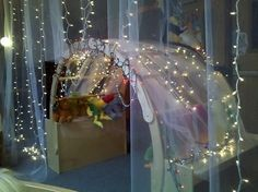 mesh curtain/tulle with icicle lights behind it