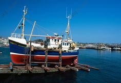 Fishing vessel on the dry dock, Newlyn, Cornwall. England, United Kingdom.