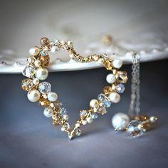 Pearl and Crystal Sterling and Gold Filled Wire Wrapped Heart Lariat - SALE 15% Off. $135.00, via Etsy.