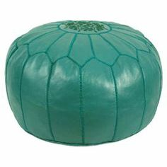 """Handmade leather pouf in teal with a foam fill and decorative stitch detail.    Product: PoufConstruction Material: Genuine leather and shredded foam fillColor: TealFeatures:    Handmade in MoroccoCan be used as an ottoman or extra seating  Dimensions: 12"""" H x 21"""" Diameter"""