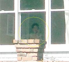 This was submitted by André who took this photo in Auckland, New Zealand. You have to look into the bottom window of the house. The lady has dark hair and is wearing what appears to be a choker, or high collar. Her clothing is completely out of place with the current period, and another factor is that she appears to have a skeletal face upon closer inspection. This type of apparition is very rare to capture.