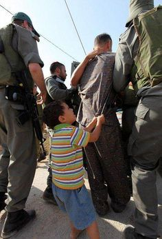 A Palestinian child is trying to safe his father from being arrested by some Israeli soldiers, using just his little hands to grab him. This is just heartbreaking! State Sponsored Terrorism, Heiliges Land, Palestine History, The Little Prince, Photos Du, Cute Love, Human Rights, Cool Pictures, Father