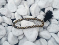 Gold hematit wih pompom