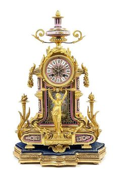 A Louis XVI Style Gilt Bronze and Sevres Style Porcelain Mounted Mantel Clock,having an urn form finial over the circular dial with Roman hours, surrounded by a laurel wreath, flanked by wreath drop finials, above a central maiden support flanked by acanthus leaf and torch decoration raised on square feet, further raised on a shaped giltwood base, having an A&N time and strike movement.  Height 18 3/4 inches.