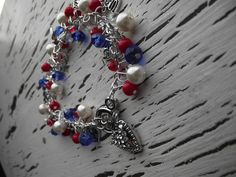 $15.00 Red white and Blue Beads  with stars and USA charms  on it Very pretty Fourth Of July Bracelet