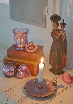 Pink, candles and an old religious statue - some of my favorite things! Taken in Fifi's guest house.