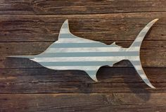 A personal favorite from my Etsy shop https://www.etsy.com/listing/210704405/distressed-blue-marlin-striped-gray-and