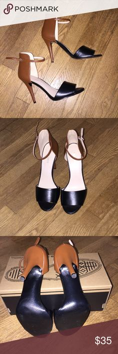Nine West Two Tone Color Stiletto Sandal Gorgeous Nine West open toe stiletto sandals. Worn only a handful of times there is no damage and the only sign of wear is the soles. Beautiful cognac brown with black leather like material. The heel is 4 and 1/2 inches. Nine West Shoes Heels