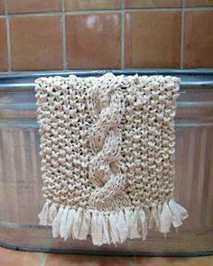 Free rag knitting pattern for a bath mat. Uses two twin sheets! Genius!