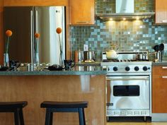"Picking a backsplash? ""Tape color and tile samples to the walls to see what they look like throughout the day as natural light changes...Choose one main color and a couple of accent colors to use throughout the kitchen, including the backsplash."""