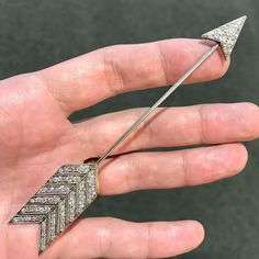 A rather large example of a diamond and gold 'arrow' jabot pin, circa 1920. Coming up for sale at Dupuis Important Jewels Auction this Fall. #dupuis #antique #jewels #diamond #jabot #jewelry