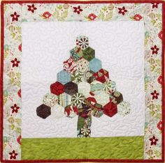"Happy Hexies Tree Wall Quilt By Maloney, Tricia Lynn  - 20in x 22in. Project Time: 6 Hour+. Fabric Type: Square Friendly. Project Type: Quilt  CLP patterns are printed on 8-1/2"" x 11"", anti-copy card stock. Because they are customized with your shop's Bill-to account name, phone number and web site, they are not returnable."