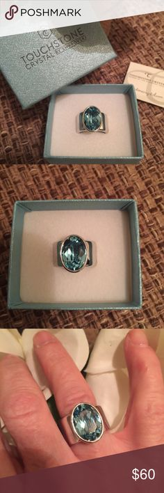 Touchstone by Swarovski Ring Beautiful Touchstone by Swarovski ring with an acquamarine stone.  Worn a few times for special occasions. A few slight scratches around band barely noticeable. Touchstone by Swarovski Jewelry Rings