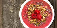 We made our vibrantly colored raspberry smoothie bowl with creamy Vanilla Shakeology and decorated it with fiber-filled oats and crunchy seeds. Get the recipe.