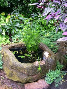 great stone water feature for a small garden/yard