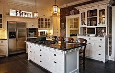 like: hardware.  white color.  dark floor & counter tops. also the detailing under the countertop edge and hutch trim.