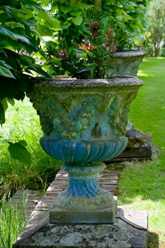 Decorative painted urn in classical garden.