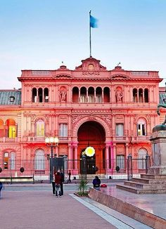 Visit the Pink House (La Casa Rosada) in Buenos Aires. Stay for the street performances market stalls (check out the mate sets) in the square.
