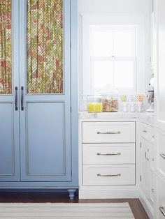 The blue pantry stands out amongst the white #kitchen cabinets #hgtvmagazine http://www.hgtv.com/decorating-basics/18-ways-to-use-the-color-blue/pictures/page-5.html?soc=pinterest