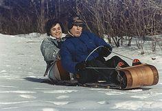 George H.W. Bush sledding with his daughter at Camp David.