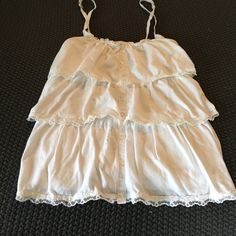 Tank top White hollister ruffle tank. Small stain to front. See pic Hollister Tops Tank Tops