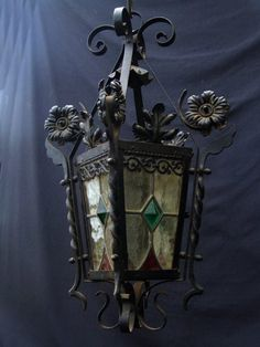 Victorian wrought iron stain glass lantern.