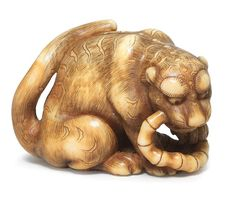 An ivory netsuke of a tiger By Okatomo, Kyoto, early 19th century;  sold 39,158USD. 08/11/16.