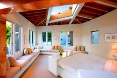 Creamy Peach Colored Bedroom with Open Ceiling