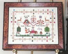 Christmastime Sampler is the title of this cross stitch pattern from Samplers Remembered.