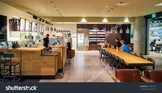 Saint Petersburg, Russia - August 04, 2015: Starbucks Cafe Interior. Starbucks Corporation Is An American Global Coffee Company And Coffeehouse Chain Based In Seattle, Washington Stock Photo 416655211 : Shutterstock