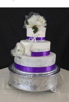 Purple and diamond ribbon wedding cake with silk magnolia flowers Ribbon Wedding, Magnolia Flower, Noodle, Wedding Cakes, Bakery, Silk, Diamond, Purple, Flowers