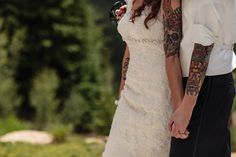 bride and groom with tattoos