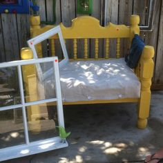 Outdoor bench made from an old bed frame, by Tess Berry.