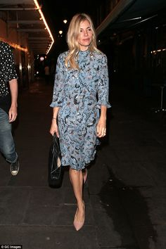 Classic: Sienna's glamorous frock was paired with some classic accessories including a pai...