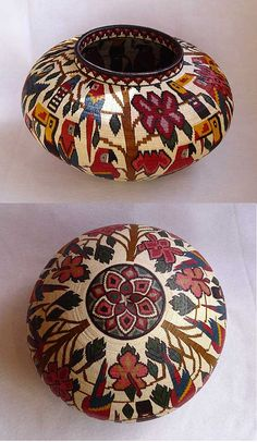 """Parrots"" Woven Wounaan basket by ANITA COCHO - Hosig di are fine baskets by the Wounaan Indians of the Darien Rainforest of Panama. Silk-fine strands of the black palm Astrocaryum standleyanum, called chunga, colored with vegetal and organic dyes, are sewn over coils of Carludovica palmate, called naguala. READ MORE @ http://turqtortsedona.com/Artists/wounaan/Wounaan-baskets.htm"