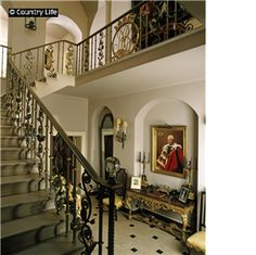 The staircase hall at Arundel Park. The wrought iron balustrade incorporates the Norfolk cypher and coronet. The house was built in by Claud Phillimore in the grounds of Arundel Castle. Wrought Iron Stair Railing, Arundel Castle, Hallway Designs, Medieval Castle, Life Pictures, Architectural Elements, Amazing Architecture, Stairways, Country Life