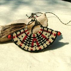 Fashion jewelry macrame necklace in black, white and red.