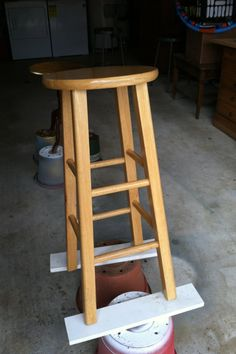 Barstools can be expensive, and it seems there are always a million different styles—and as we all know, styles change quickly. This is why I chose to update my barstools, rather than spend more money on new ones. You can easily update your barstools in a weekend with a couple cans of spray paint and some fabric.