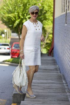 White linen sun dress. Love those gingham wedges. Appropriate jewelry and bag make the outfit. white lights